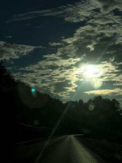 Sun Sunbeam Lens Flare Transportation Road Sky No People Nature Sunlight Sunset Scenics Cloud - Sky Outdoors Beauty In Nature Day