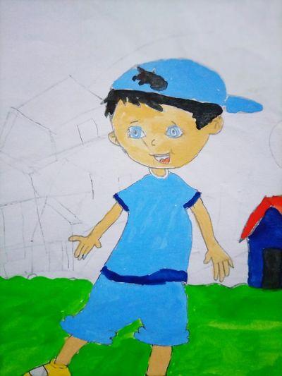 Full length of boy standing against blue wall