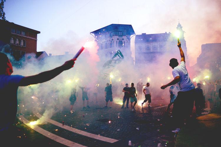 People bursting firework at street