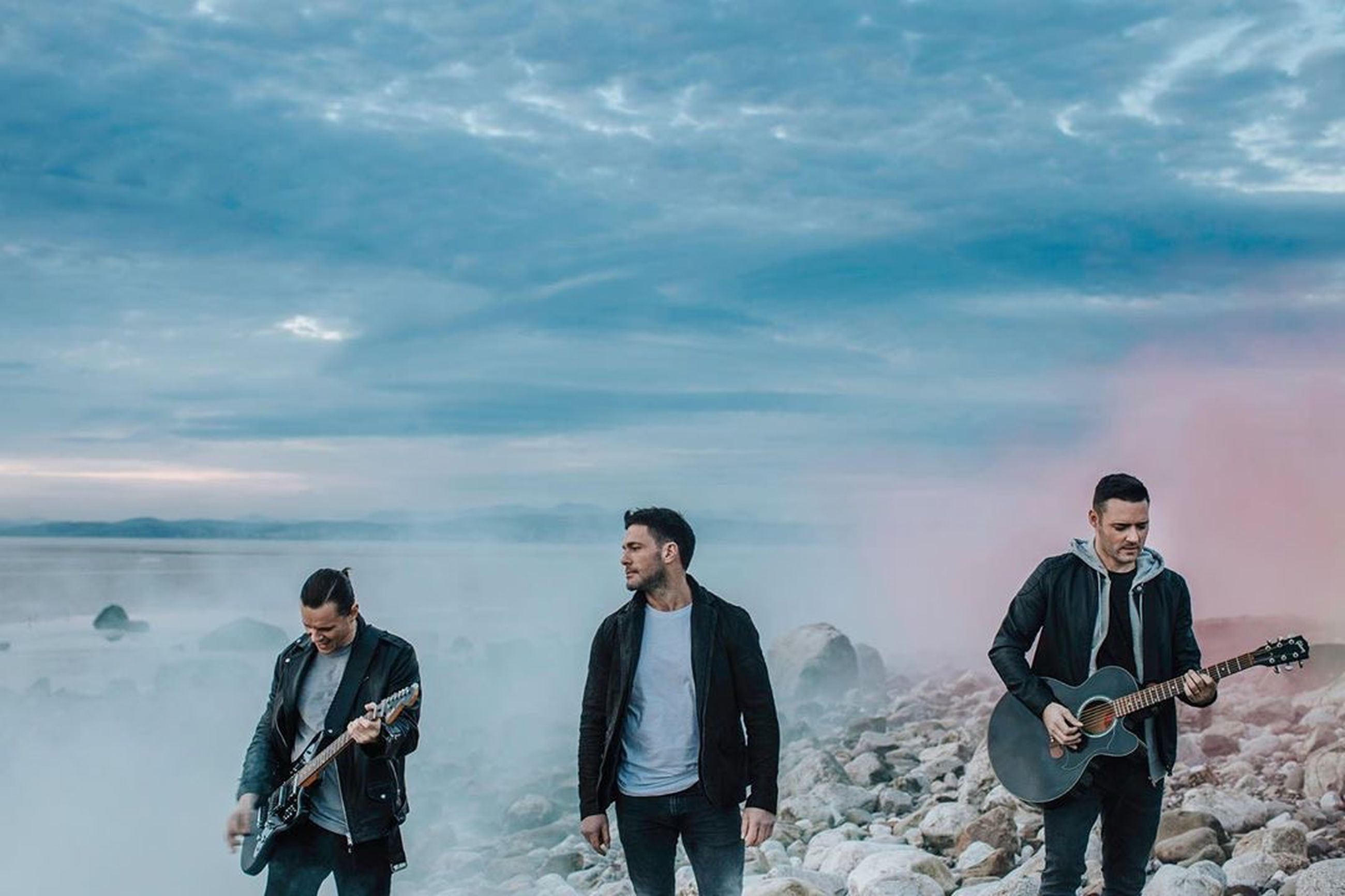 sky, young men, cloud - sky, men, leisure activity, real people, young adult, lifestyles, front view, sea, casual clothing, musical instrument, standing, nature, people, togetherness, guitar, string instrument, friendship, outdoors