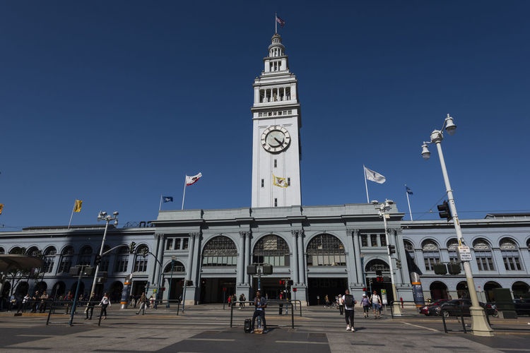 San Francisco Ferry Building, Ferry Pier during Day Time America Architecture Bay Blue Bridge Built California Car City Cityscape Clock Clock Tower Dock Embarcadero Famous Ferry Francisco Harbor Historic History Landmark Landscape Market Old People San San Francisco Scene SF Sky Skyline Square States Street Tourism Tourist Tower Transportation Travel Trolley United United States Urban USA View Water Waterfront