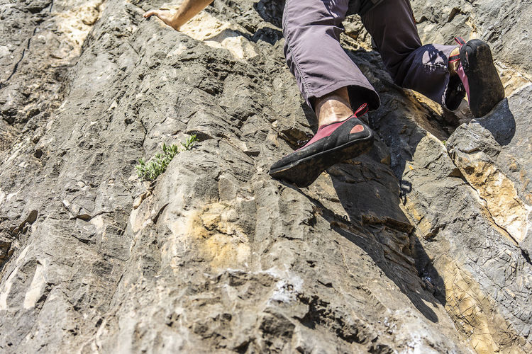 Alone Low Section Human Leg Leisure Activity Human Body Part Lifestyles Rock Day Shoe Outdoors Human Foot Climber Climbing Climbing Shoes Balance Adventure Mountain Mountain Sports Solo Climbing Grey Rock Grey Color Alone Dangerous precision Climb