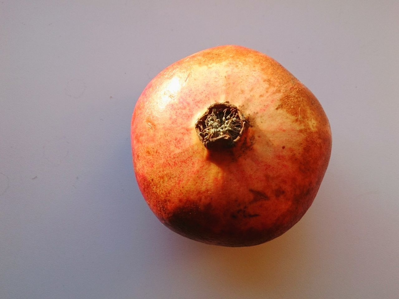 Close-Up Of Pomegranate On White Table