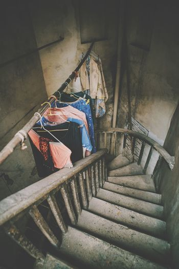 High Angle View Of Clothes Drying On Staircase In Building