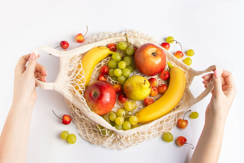 Midsection of woman holding fruits