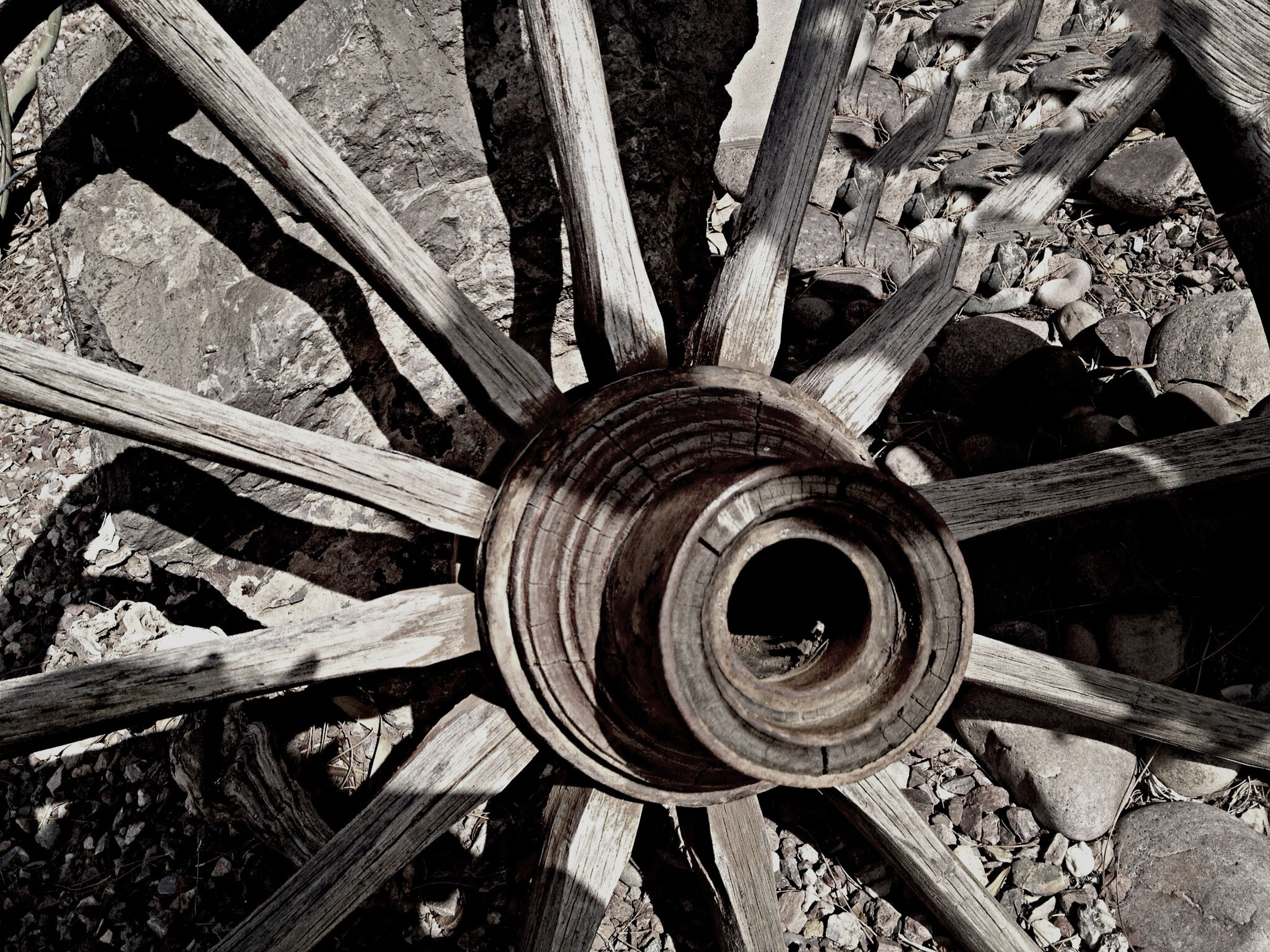 metal, old, abandoned, rusty, wheel, damaged, metallic, obsolete, close-up, deterioration, high angle view, run-down, machine part, built structure, weathered, pipe - tube, no people, day, part of, sunlight