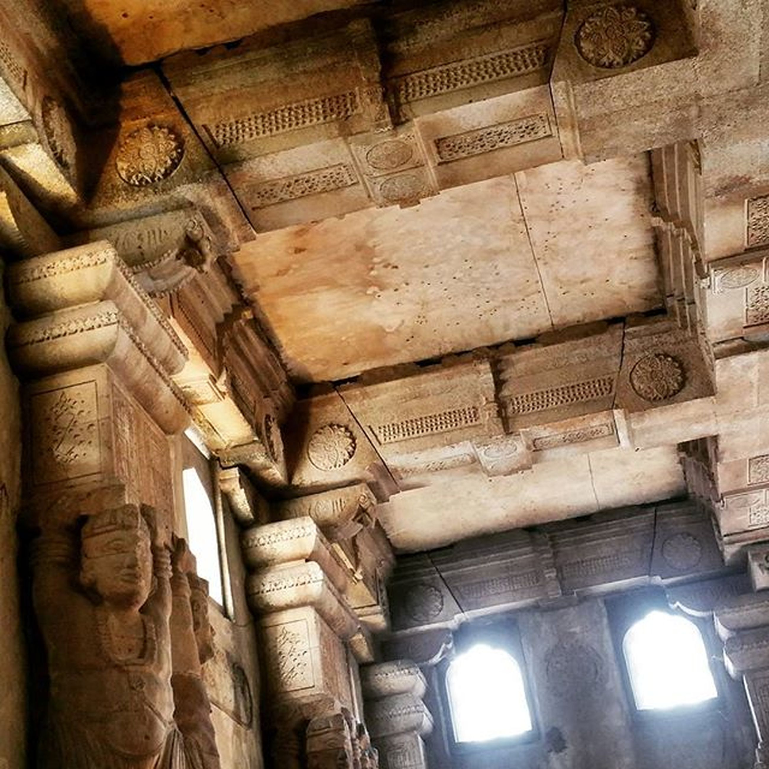 architecture, built structure, low angle view, history, statue, art and craft, art, sculpture, human representation, building exterior, carving - craft product, old, creativity, the past, architectural column, ancient, arch, famous place, column