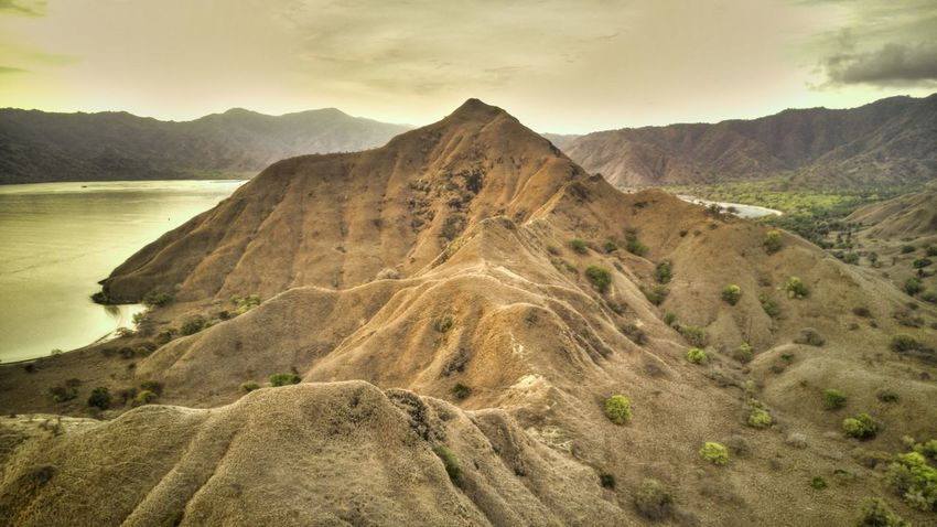Komodo Island, Flores, Indonesia. Scenics - Nature Beauty In Nature Komodo Island Flores INDONESIA Tropical Climate Sunset Sky Tranquil Scene Tranquility No People Nature Cloud - Sky Idyllic Outdoors Drone Shot Aerial View Drone  Land Mountain Mountain Range Landscape Environment Rock Climate Arid Climate Mountain Peak Rock - Object Non-urban Scene Remote Formation