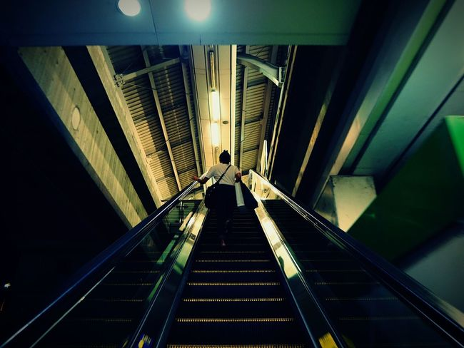Going upGoing Up Indoors  Staircase Steps And Staircases Steps Architecture Built Structure Illuminated Adults Only One Person People Adult Subway Station One Man Only Technology Only Men Futuristic Day