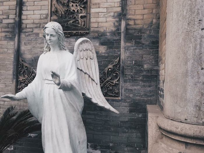 Statue of angel outside temple