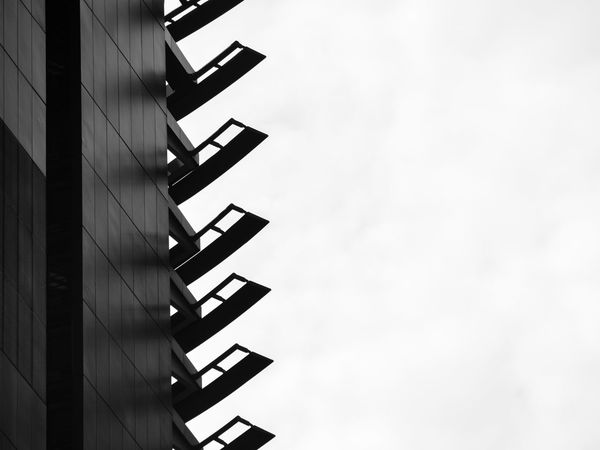 Blade shaped sunshades of modern building, in black and white Architecture Building Building Exterior Copy Space Pattern In A Row Sunshades Blades Knife Shapes Silhouette Black And White Photography Abstract Abstract Photography
