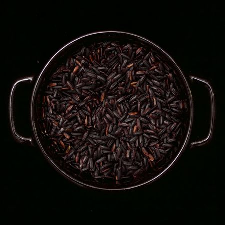 black rice in a black bowl on a black background Black Background Black Rice Bowl Food Freshness No People Raw Food Rice Studio Shot