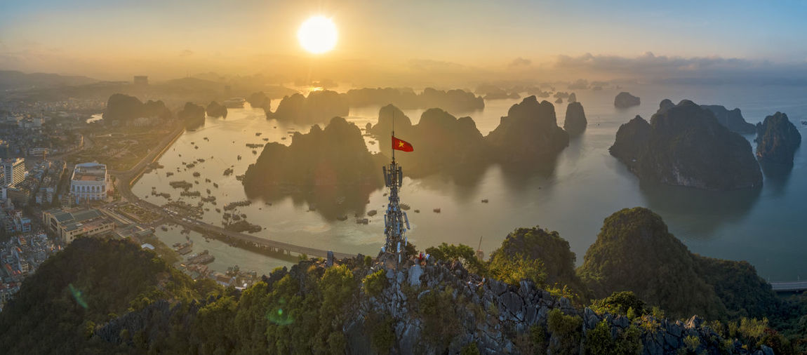 Beauty In Nature Sky Sunrise High Angle View Nature Water Building Exterior Cityscape City Mountain Ha Long Bay Vietnam Boat Fishing Boat Road Limestone Islands Sea Seascape Sea And Sky Flags In The Wind