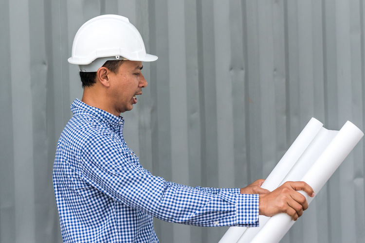 Side View Of Architect Working At Construction Site
