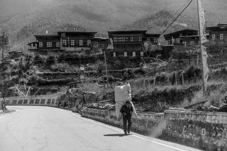 Bhutan, the world's only carbon negative country is also a traveler's paradise- from the mountains to the serene monasteries, it is culturally and naturally gifted. The Traveler - 2018 EyeEm Awards Travel Travel Photography Bhutan Color Monks Travel Destinations