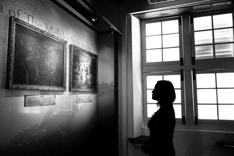 Boy standing in window