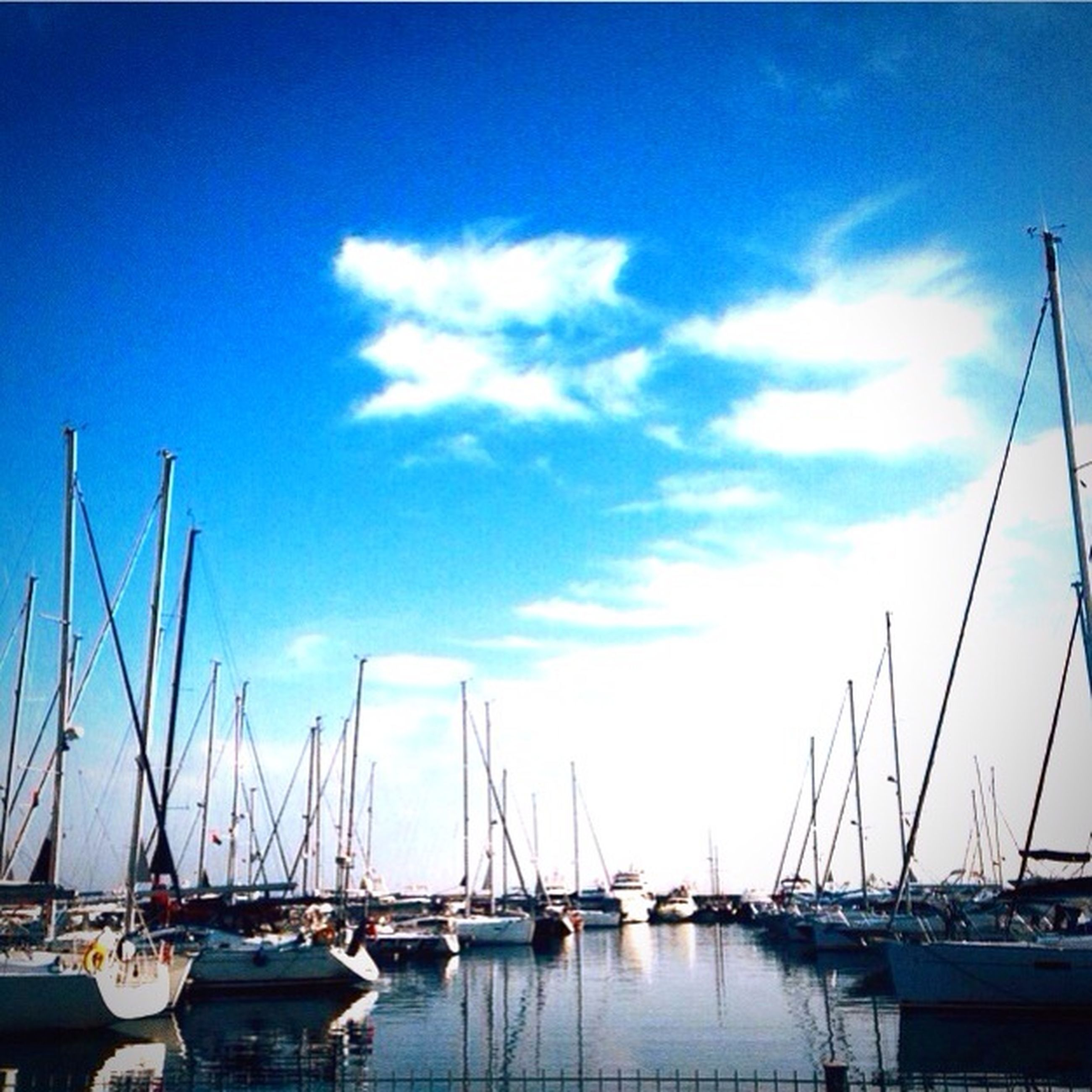 nautical vessel, moored, transportation, water, boat, mast, mode of transport, harbor, sailboat, sky, sea, waterfront, blue, reflection, marina, cloud, cloud - sky, nature, outdoors, tranquility