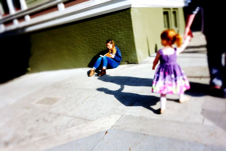 Lifestyles Casual Clothing Sunlight Eyeemphotography Shadowplay Real People Leisure Activity Young Adult Day Outdoors Childhood Females People Togetherness Bonding Adult Redhair Child Sitting On The Sidewalk Reading A Book Eyemphotography December San Francisco