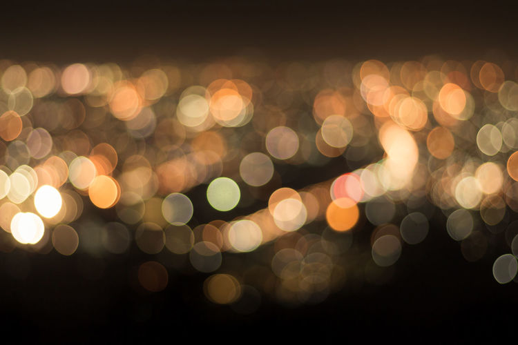 Abstract Abstract Backgrounds Backgrounds Circle City Defocused Design Electric Light Geometric Shape Glowing Illuminated Lens Flare Light Light - Natural Phenomenon Lighting Equipment Night No People Outdoors Pattern Shape Spotted Street Textured Effect