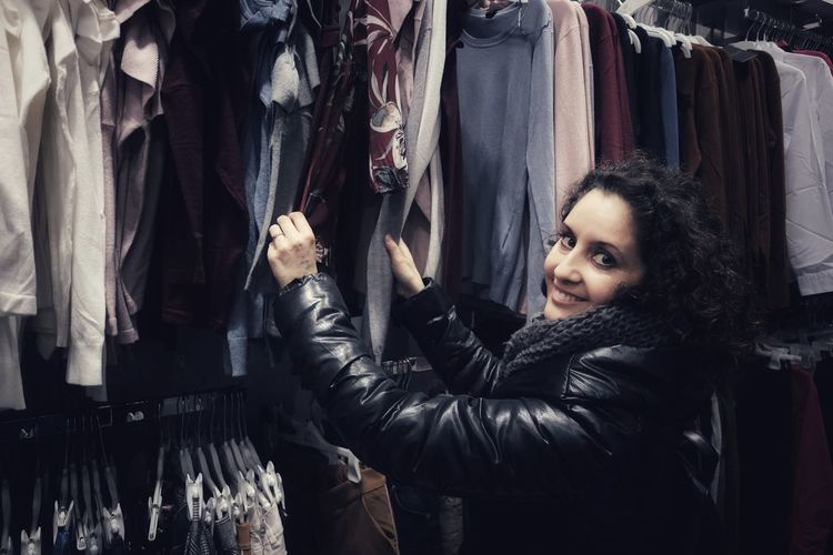 Portrait Of Smiling Mature Woman Buying Clothes In Store