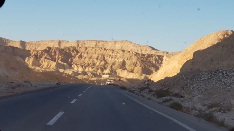 Desert Arid Climate Road Mountain Rock - Object Sky Landscape Mountain Road Arid Landscape Rocky Mountains Physical Geography Canyon Eroded Winding Road Geology Depression - Land Feature Rock Formation Rugged Mountain Range Cliff Quarry Barren Sandstone Natural Landmark Rock Hoodoo