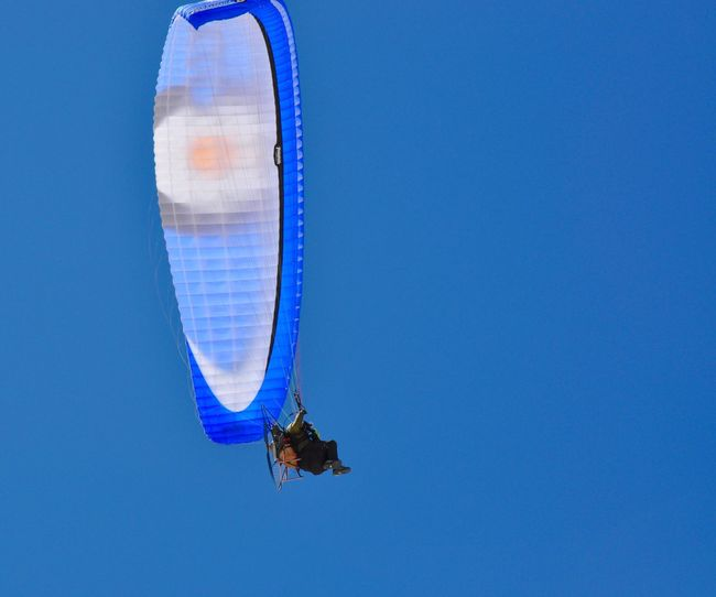 Powered paraglider in clear blue sky in Lancelin, Western Australia. Adrenaline Junkie Adventure Blue Chair Clear Sky Extreme Sport Extreme Sports Fun Hanging Lancelin Leisure Activity Lifestyles Low Angle View Motorized Nature One Person Outdoors Parachute Paragliding Paramotoring Powered Paragliding Real People Recreational Pursuit Sport Western Australia