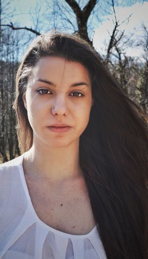 Women Around The World EyeEmNewHere. In The Wood Branches And Sky Nature Wind Girl Beauty Brown Hair Long Hair Look At Me Now Look No Make Up White Piercing Rijeka City Photography EyeEmNewHere The Portraitist - 2017 EyeEm Awards