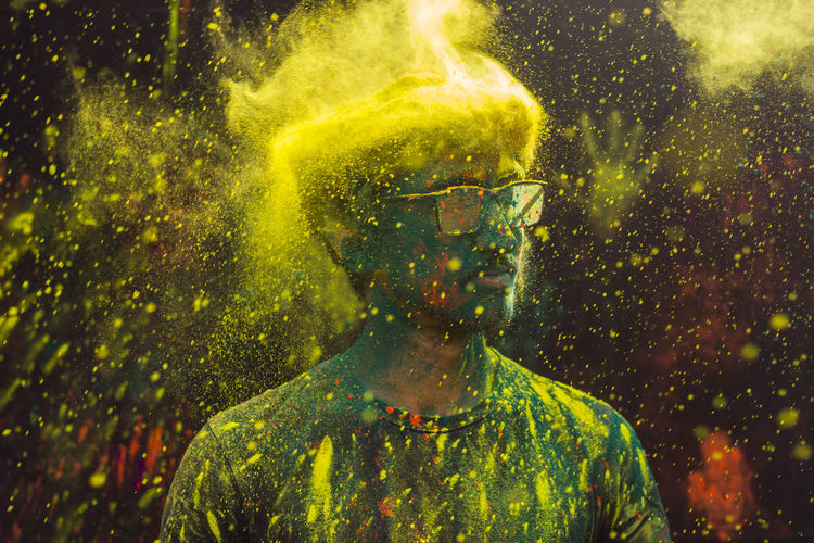 Close-up of man covered with powder paint during holi