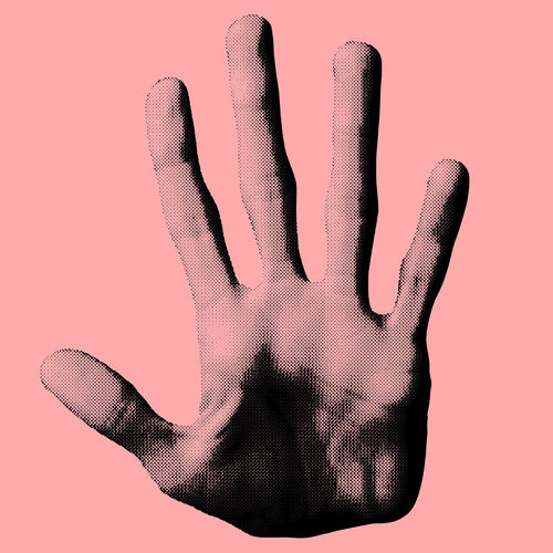 Close-up of human hand against colored background