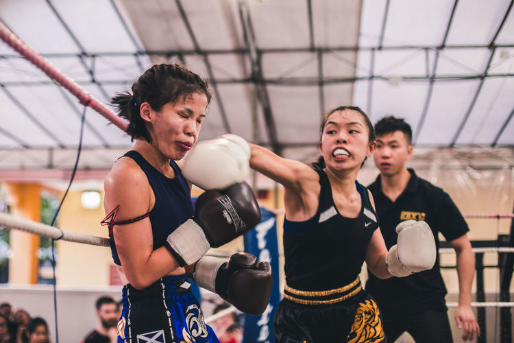 Smack on. International Women's Day 2019 Real People Sport Young Adult Healthy Lifestyle Exercising Vitality Strength Muay Thai Fighting Women Young Women Kickboxing Punching Hitting Analogue Sound