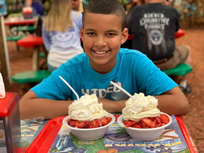 Strawberries EyeEm Selects Food Food And Drink Childhood Boys Child Portrait Incidental People Smiling Sitting Happiness Looking At Camera Unhealthy Eating Freshness Table Casual Clothing Front View Stawberries The Foodie - 2019 EyeEm Awards