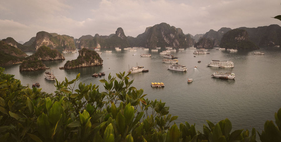 Boat in Ha Long Bay, Vietnam Architecture ASIA Bay Beauty In Nature Cloud - Sky Day Landscape Landscape_Collection Landscape_photography Mode Of Transport Mountain Mountain Range Nature Nautical Vessel No People Outdoors Panoramic Scenics Sky Sunset Tranquil Scene Tranquility Transportation Vietnam Water