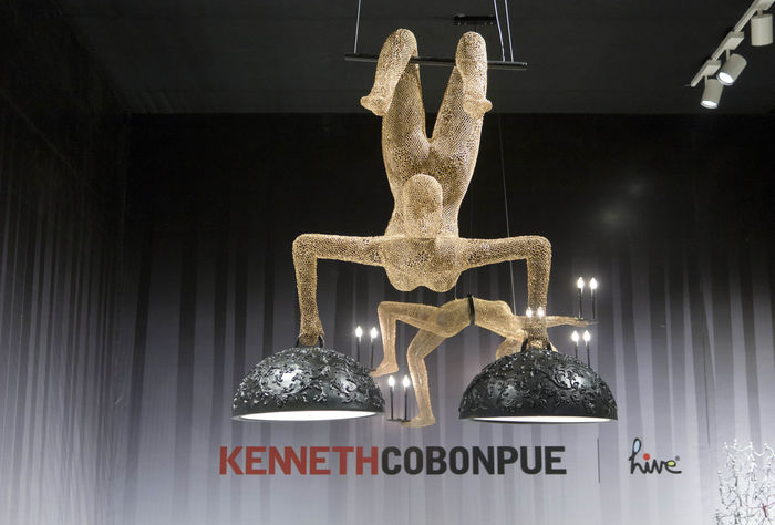 MILAN, ITALY - APRIL 15 2015: Design lamps with acrobat and trapeze by Kenneth cobonpueon show at Milanese design week in Milan, Italy Balance Design Furniture Kenneth Cobonpue Lamp Lighting Lights Object Suspension Trapeze Artist Trapezist