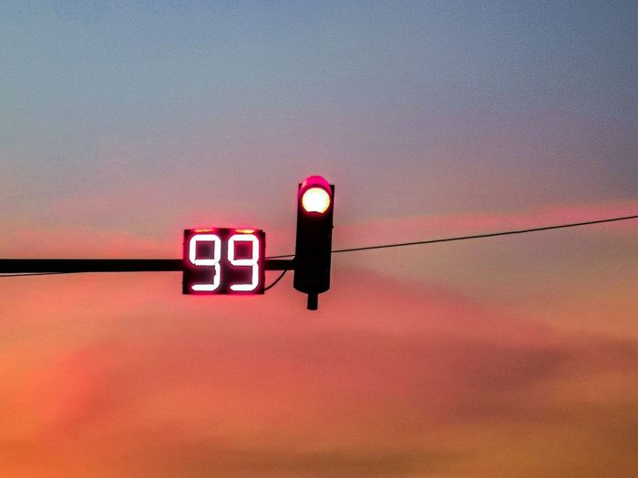 Road countdown timer in a sunset. 99 seconds to go.