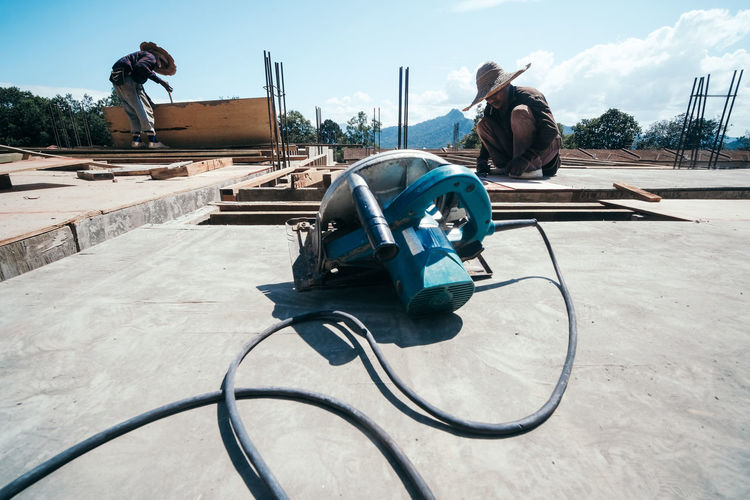Workers working on building at construction site