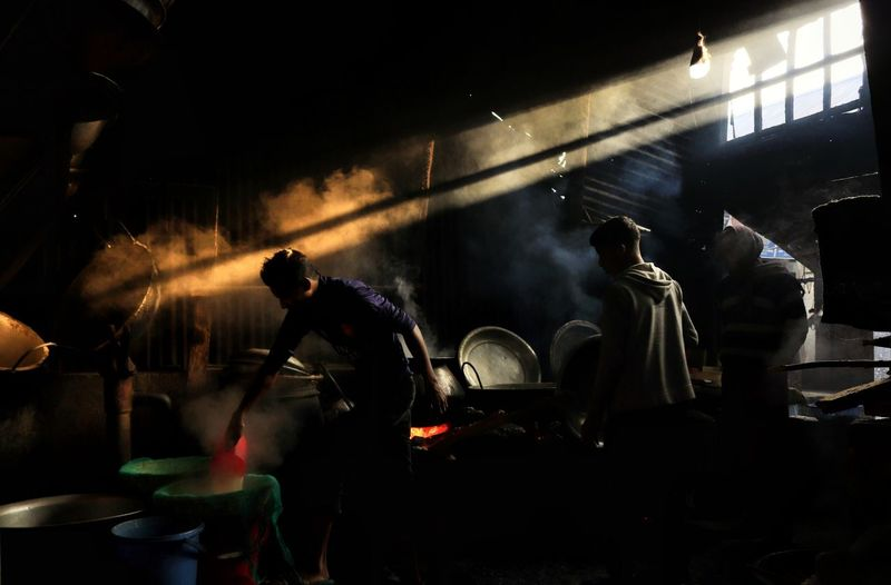 Group of people cooking at village market