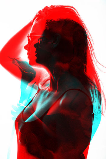Digital composite image of woman standing against red background