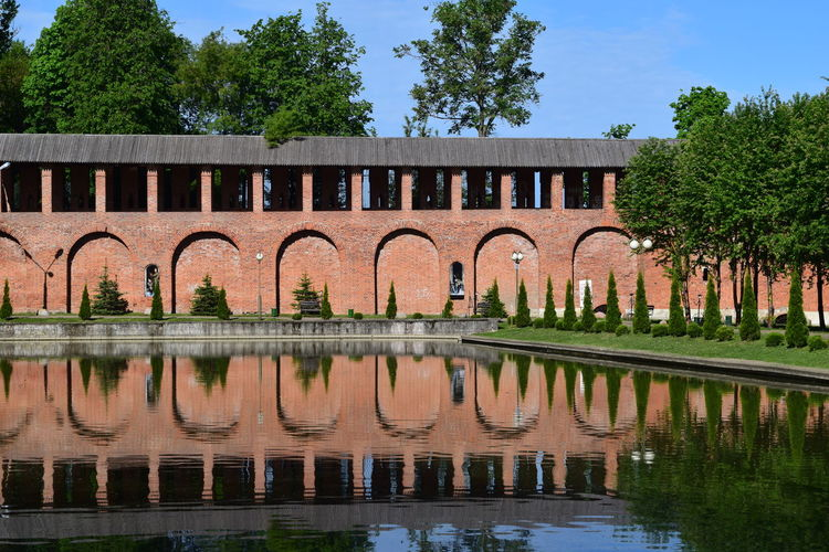 Architecture Reflection Built Structure Water Tree Plant Building Exterior Waterfront Nature Sky No People Lake Day Arch Outdoors Building Connection Bridge Park Park - Man Made Space Landscape Lake View Lakeside Tranquility Tranquil Scene Wall - Building Feature Wall Bridge - Man Made Structure Brick Wall Historical Building History Relaxing Riverside Summertime Summer Views