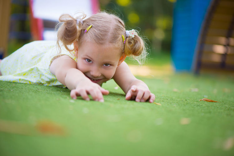 Portrait of cute girl playing outdoors