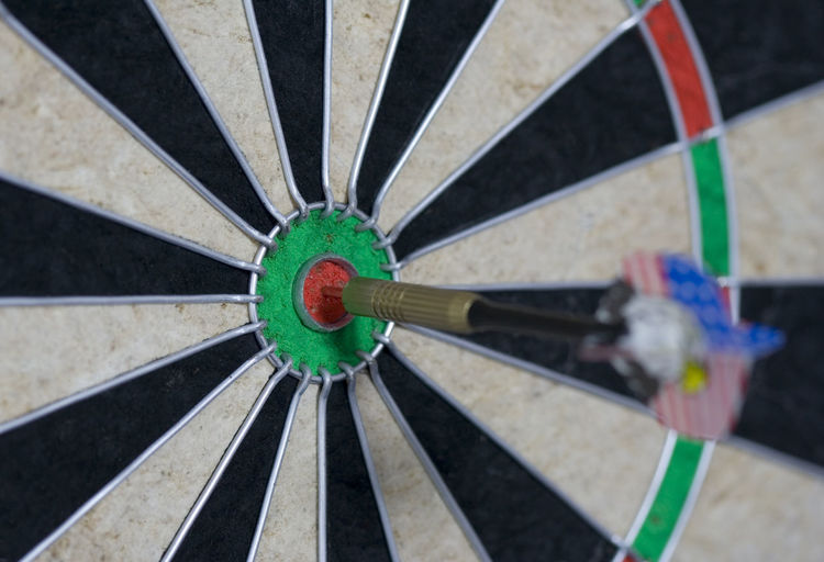Close-up of dart on sports target