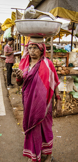 Rear view of woman standing at market