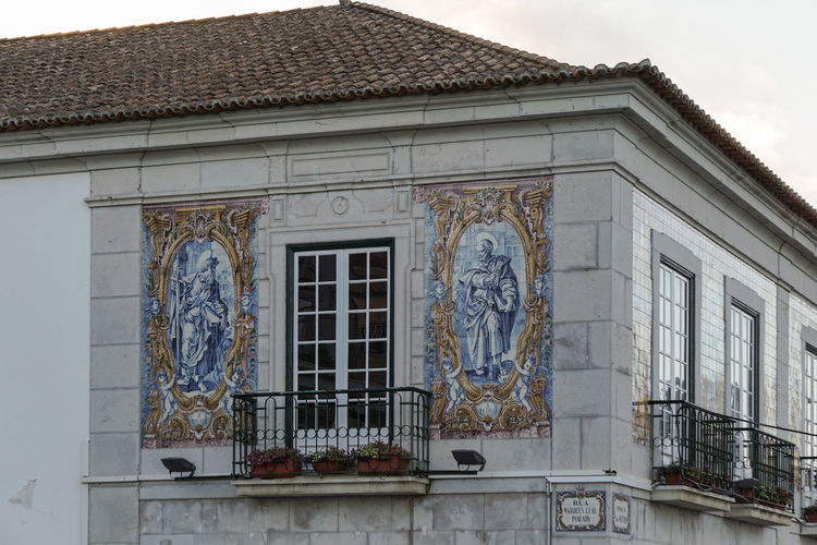 Building overlooking harbour at Cascais. Decorated with tiles. Cascais Portugal Architecture Art And Craft Balcony Building Exterior Built Structure Creativity Day Human Representation Low Angle View Male Likeness No People Outdoors Sculpture Sky Statue Summer Tiles Travel Destinations Window