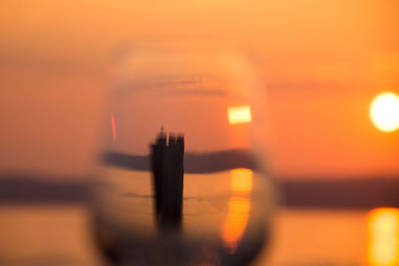 Sunset in a glass Glass Art Glass Sky Sunset No People Architecture Built Structure Orange Color Nature Illuminated Travel Destinations Waterfront Water