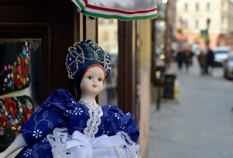 Midsection of  doll wearing traditional costume at store