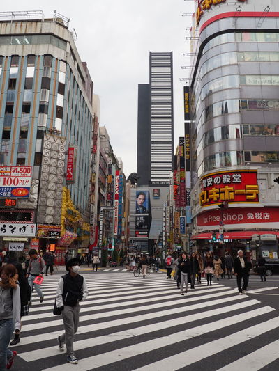 Adult Adults Only Architecture Building Exterior City City Life City Street Crowd Cultures Day Modern Outdoors Pedestrian Walkway People Retail Place Shinjuku Sky Skyscraper Street Travel Destinations