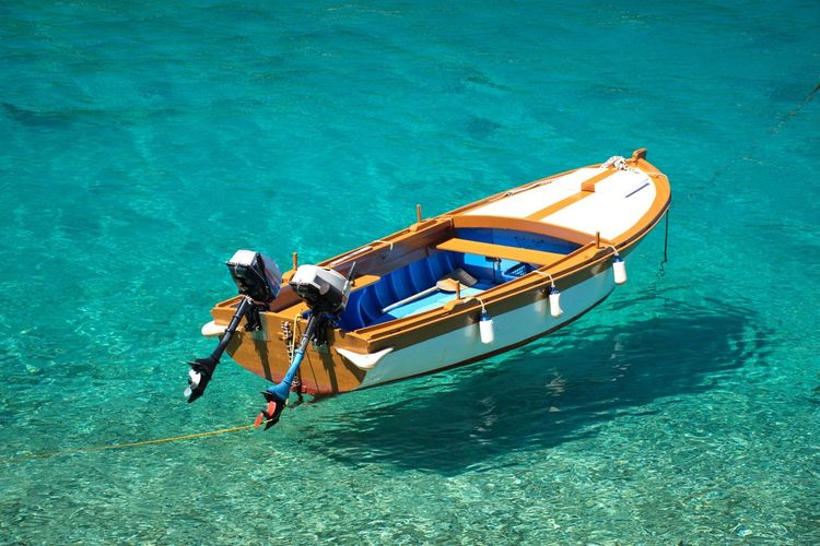 High angle view of wooden boat on turquoise clear sea