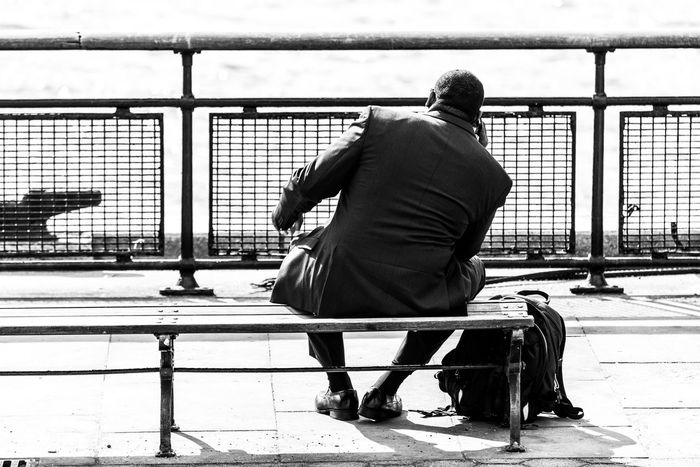 Adult Architecture Black And White Black And White Photography Black Color Casual Clothing Day Full Length Men NYC One Person Outdoors People Phones Real People Rear View Sitting Smart Phone United States The Street Photographer - 2017 EyeEm Awards The Photojournalist - 2017 EyeEm Awards