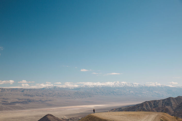 Arid Climate Arid Landscape Beauty In Nature Blue Sky Day Death Valley Death Valley National Park Desert Desert Landscape Mountain Mountain Range Mountains Nature Nature One Person Outdoors Physical Geography Roadtrip Scenics Sky Tranquil Scene Tranquility