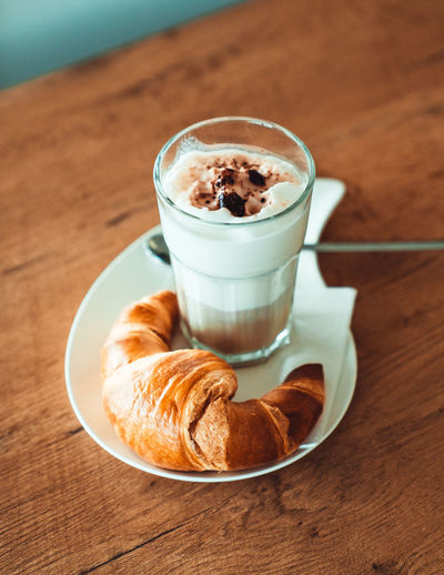Latte with a croissant Food And Drink Coffee Food Coffee - Drink Table Coffee Cup Croissant Cup Mug Baked Freshness Drink Refreshment Still Life French Food Indoors  Cappuccino Sweet Food High Angle View No People Hot Drink Breakfast Frothy Drink Latte Meal