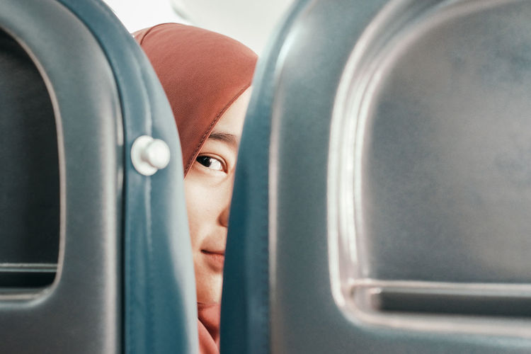 An Eye For Travel Flying Home Travelling Woman In Hijab Aircraft Airplane Close-up Human Face Journey One Eye Transportation Young Women Press For Progress
